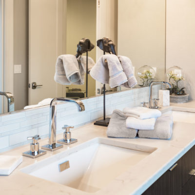 Bathroom detail in new luxury home: colorful vanity with cabinet